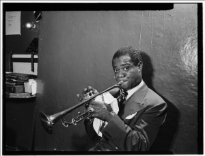 Image of Louis Armstrong, the namesake of Satchmofest, which is recommended by Joieful in New Orleans, LA