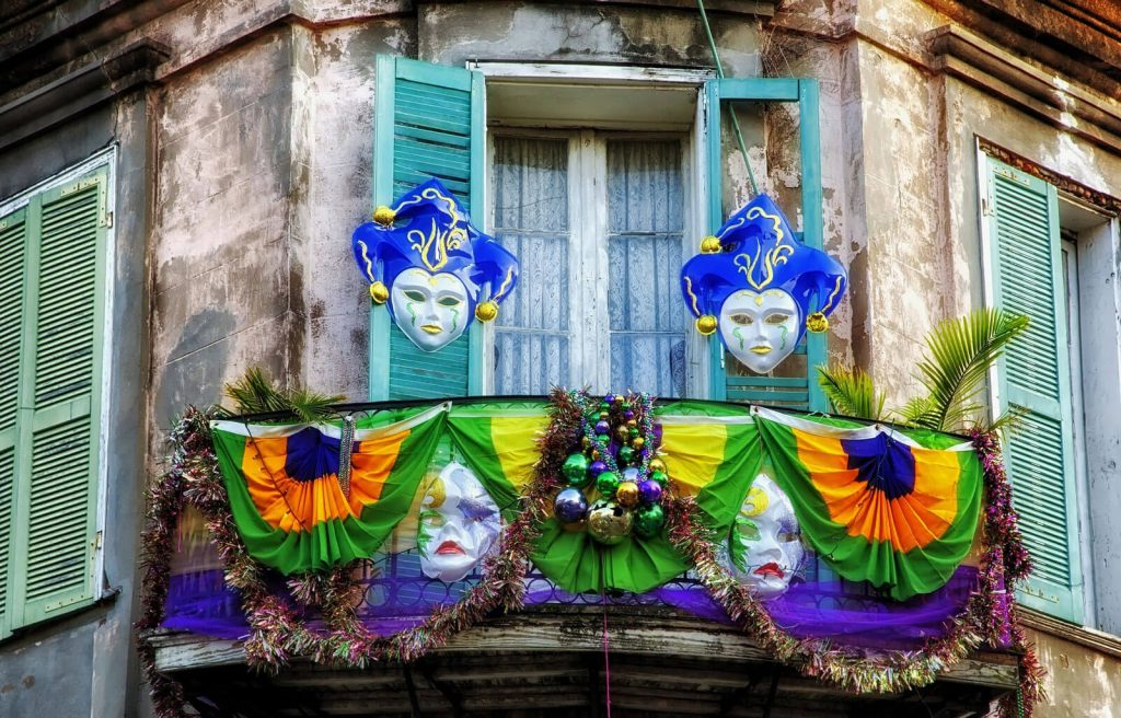 A French Quarter balcony decorated for Mardi Gras in New Orleans, LA