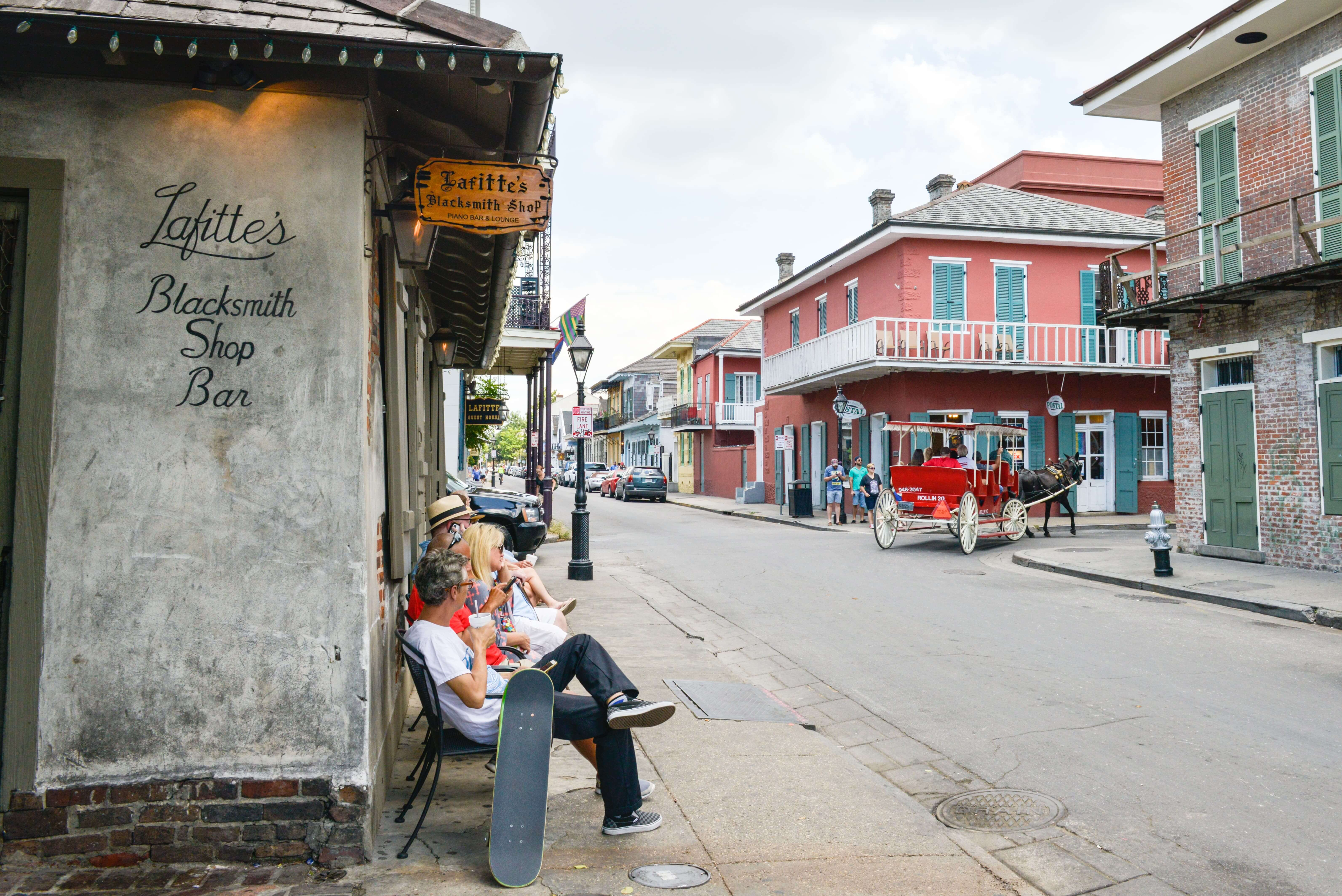 People sitting in the French Quarter of New Orleans></p> <p>It starts in the French Quarter, the oldest part of the city and one of the oldest neighborhoods in the United States. A number of buildings date to the early and mid-18th Century. Take a <a href=