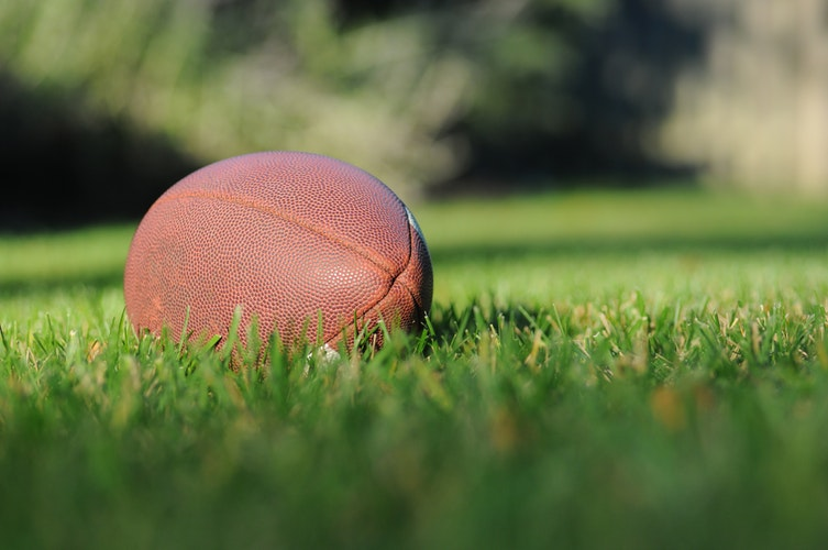 A football laying in the grass